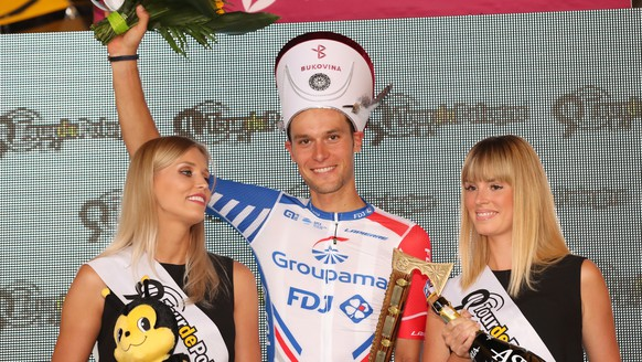 epa06939279 Austrian cyclist Georg Preidler of the Groupama-FDJ team celebrates on the podium after winning the sixth stage of the 75th Tour de Pologne 2018 cycling race over 129 km from Zakopane to Bukowina Tatrzanska, in Bukowina Tatrzanska, Poland, 09 August 2018.  EPA/Grzegorz Momot POLAND OUT