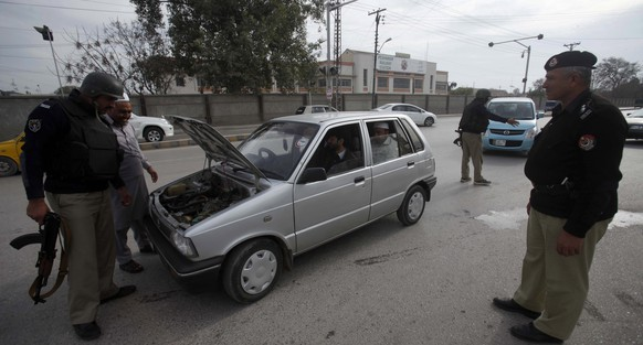 epa05799216 Pakistani security officials check a vehicle at checkpoint as security has been intensified across the country after suicide bombing at the shrine of Sufi Muslim Saint Lal Shahbaz Qalander in Sehwan, in Peshawar, Pakistan, 17 February 2017. At least 83 people were killed and more than 250 injured in the incident. According to media reports, the so-called 'Islamic State' (IS) claimed responsibility for the bombing.  EPA/BILAWAL ARBAB