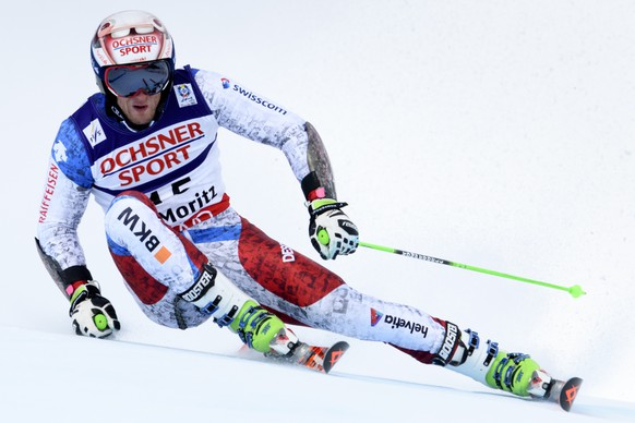 Switzerland's Justin Murisier speeds down during the first run of the men Giant Slalom race at the 2017 FIS Alpine Skiing World Championships in St. Moritz, Switzerland, Friday, February 17, 2017. (KEYSTONE/Gian Ehrenzeller)