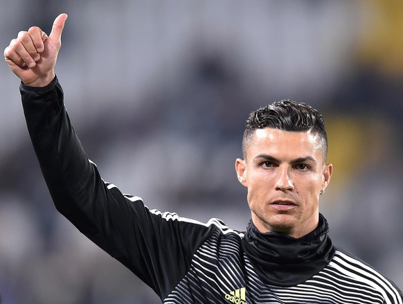 epa07423334 Juventus Cristiano Ronaldo arrives for the Italian Serie A soccer match Juventus FC vs Udinese Calcio at the Allianz  Stadium in Turin, Italy, 08 March 2019.  EPA/ALESSANDRO DI MARCO