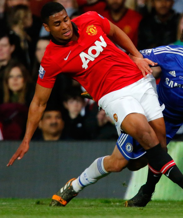 MANCHESTER, ENGLAND - MAY 14: Saidy Janko (L) of Manchester United in action with John Swift of Chelsea during the Barclays Under-21 Premier League Final match between Manchester United and Chelsea at Old Trafford on May 14, 2014 in Manchester, England. (Photo by Paul Thomas/Getty Images)