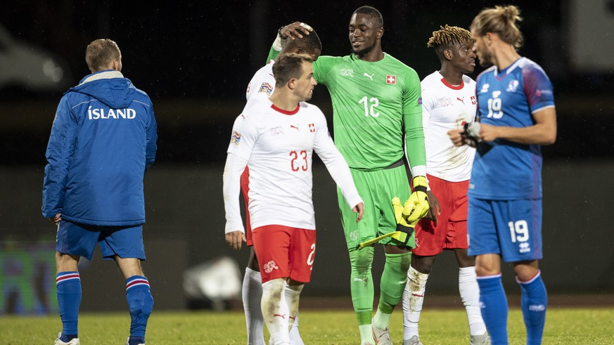 epa07095912 Switzerland's goalkeeper Yvon Mvogo (C) and teammate Xherdan Shaqiri (2-L) react after the UEFA Nations League soccer match between Iceland and Switzerland at the Laugardalsvoellur stadium in Reykjavik, Iceland, 15 October 2018.  EPA/ENNIO LEANZA