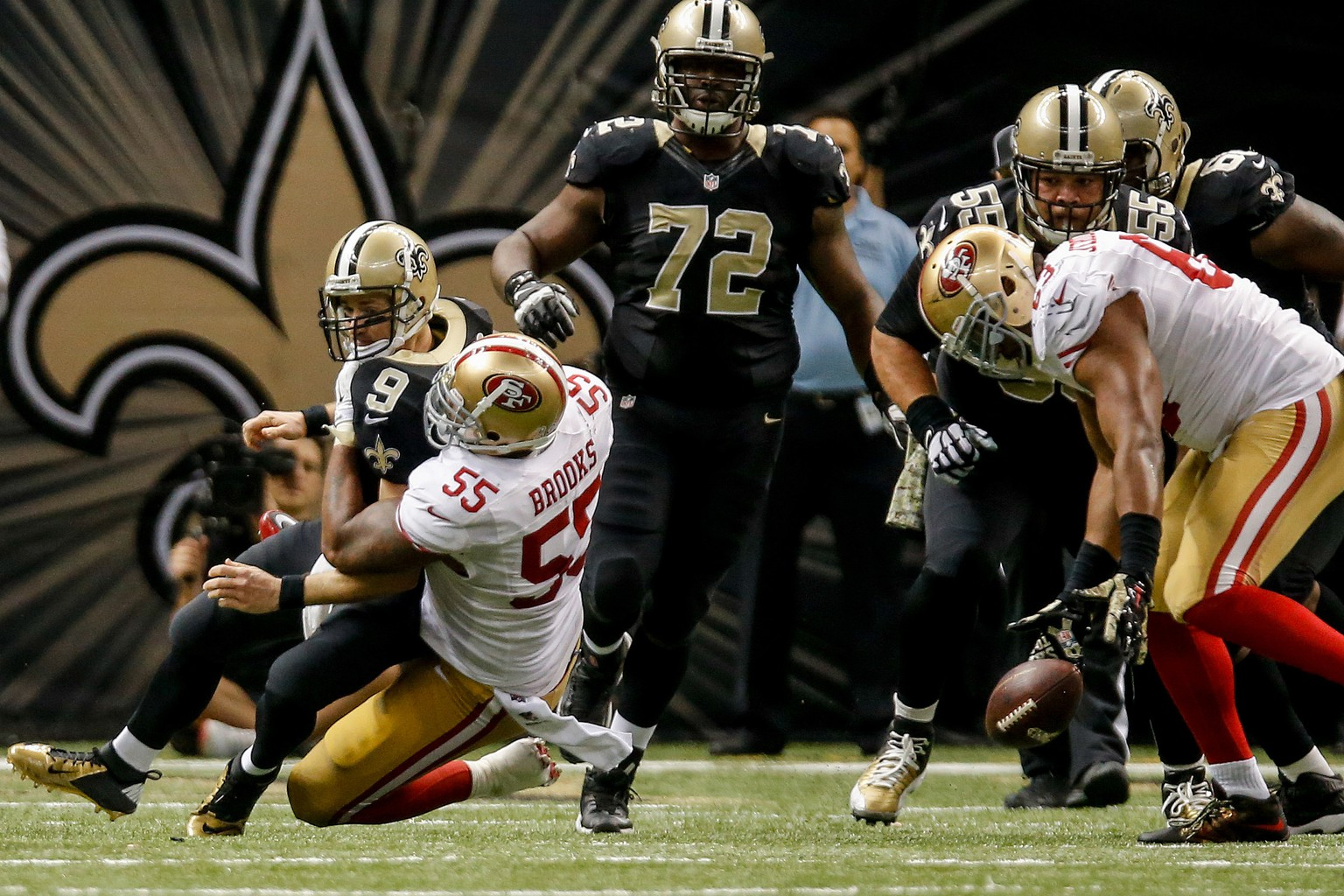 Nov 9, 2014; New Orleans, LA, USA; San Francisco 49ers outside linebacker Ahmad Brooks (55) sacks New Orleans Saints quarterback Drew Brees (9) in overtime at Mercedes-Benz Superdome. The 49ers won 27-24 in overtime. Mandatory Credit: Derick E. Hingle-USA TODAY Sports