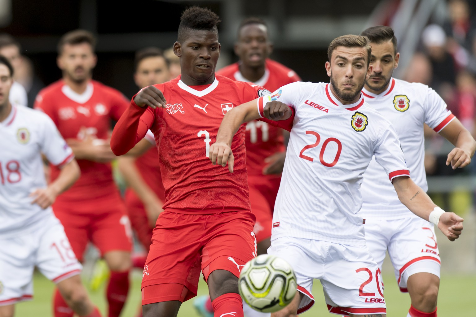 Switzerland's forward Breel Embolo, left, fights for the ball with Gibraltar's midfielder Ethan Britto, right, during the UEFA Euro 2020 qualifying Group D soccer match between the Switzerland and Gibraltar, at the Tourbillon Stadium in Sion, Switzerland, Sunday, September 8, 2019. (KEYSTONE/Laurent Gillieron)