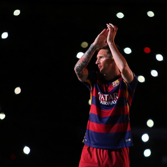 FILE - In this Aug. 5, 2015 file photo, Barcelona's Lionel Messi applauds as he enters the pitch during the presentation of the team for the new season at the Camp Nou stadium in Barcelona, Spain. (AP Photo/Francisco Seco, File)