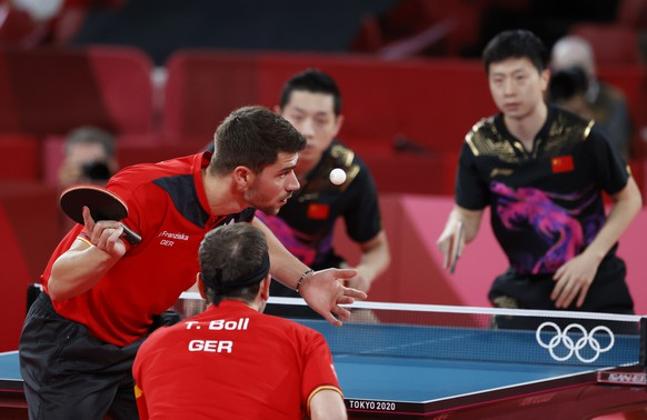 epa09400193 Timo Boll (R) und Patrick Franziska (R) of Germany in action during the Table Tennis men's team cold medal match against Ma Long and Xu Xin of China during the Tokyo 2020 Olympic Games at the Tokyo Metropolitan Gymnasium arena in Tokyo, Japan, 06 August 2021.  EPA/MAST IRHAM