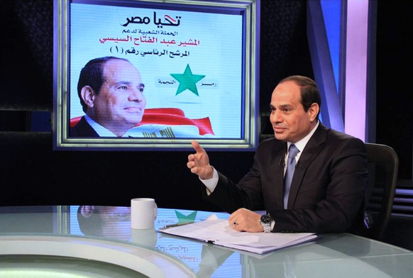 Presidential candidate and Egypt's former army chief Abdel Fattah al-Sisi talks during a television interview broadcast on CBC and ONTV, in Cairo,  May 6, 2014. Sisi, who is expected to win a presidential election this month, said in a television interview broadcast on Tuesday that costly energy subsidies could not be lifted quickly. REUTERS/Al Youm Al Saabi Newspaper (EGYPT - Tags: POLITICS ELECTIONS TPX IMAGES OF THE DAY) EGYPT OUT. NO COMMERCIAL OR EDITORIAL SALES IN EGYPT