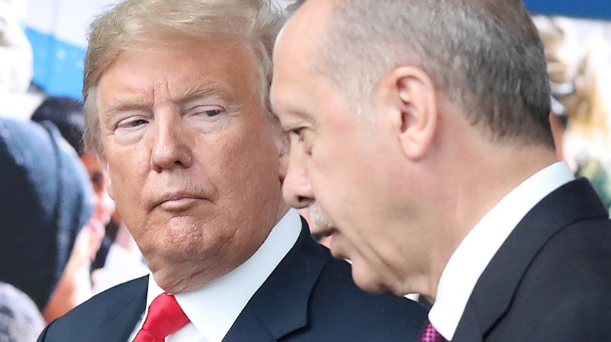 epa06943382 (FILE) - US President Donald J. Trump (L) looks at Turkey's President Recep Tayyip Erdogan (R) at NATO headquarters in Brussels, Belgium, 11 July 2018 (reissued 11 August 2018). Turkish President Erdogan condemned US President Trump's doubling of tariffs on Turkish steel and aluminium imports up to 50 percent. The Turkish lira plunged over 20 percent against the US dollar after Trump's announcement on 10 August 2018, which has been exacerbated over the disputed imprisonment of US pastor Andrew Brunson in Turkey.  EPA/TATYANA ZENKOVICH