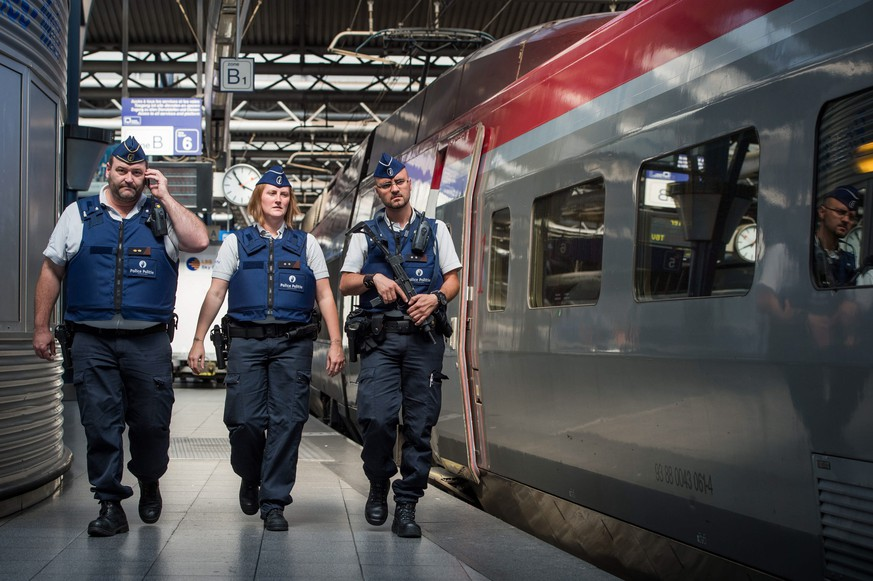epa04893134 Police officers patrolling on the Thalys train station platforms at Brussels Midi Station, in Brussels, Belgium, 22 August 2015. Security was beefed up at Brussels Midi train station after two US soldiers the previous day overpowered an armed man on a French Thalys train traveling from Amsterdam to Paris, and their quick action was credited with preventing a mass killing 21 August 2015. At least two people, including one of the soldiers, were seriously injured when the man began firing an assault weapon on the high-speed Thalys train, French officials said. A third victim was lightly injured.  EPA/STEPHANIE LECOCQ