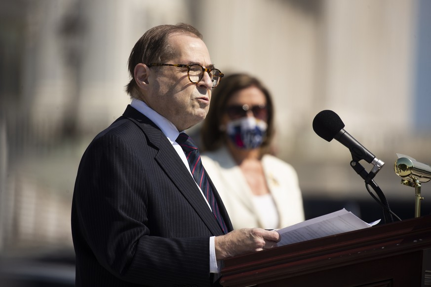 epa08508808 US House Judiciary Committee Chairman Jerry Nadler (L) speaks beside US Speaker of the House Nancy Pelosi (R) during a press event with House Democrats to discuss the George Floyd Justice in Policing Act before the House votes on the legislation, outside the East Front steps of the US House of Represenatives on Capitol Hill in Washington DC, USA, 25 June 2020. The bill is expected to die in the Republican-led Senate. The death of George Floyd while in Minneapolis police custody has sparked global protests demanding policing reform and racial equality.  EPA/MICHAEL REYNOLDS