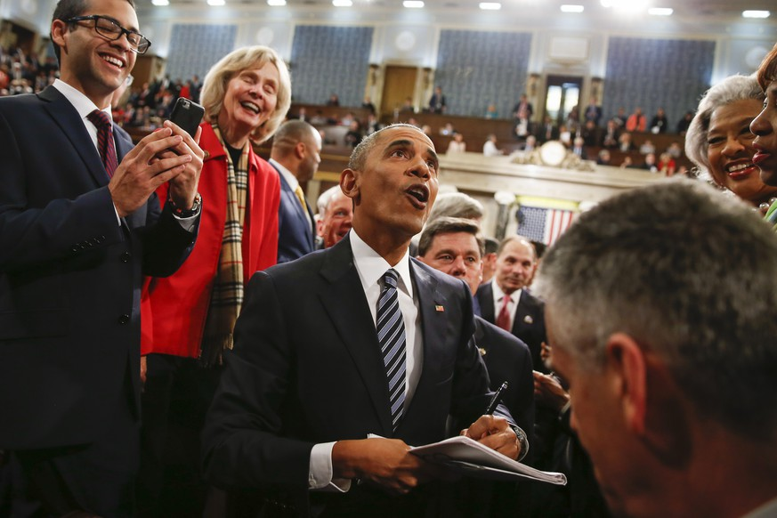 President Barack Obama looks up at the balcony as he walks back up the aisle at conclusion of his State of the Union address to a joint session of Congress on Capitol Hill in Washington, Tuesday, Jan. 12, 2016. (AP Photo/Evan Vucci, Pool)
