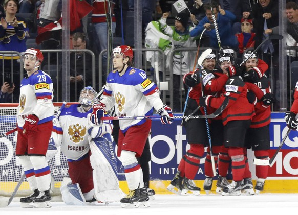 Canada's players celebrate a goal by Canada's Ryan O'Reilly, right, at the Ice Hockey World Championships semifinal match between Canada and Russia in the LANXESS arena in Cologne, Germany, Saturday, May 20, 2017. (AP Photo/Petr David Josek)
