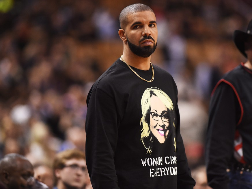 Rapper Drake watches the second half of an NBA basketball game between the Golden State Warriors and the Toronto Raptors on Wednesday, Nov. 16, 2016, in Toronto. (Frank Gunn/The Canadian Press via AP)