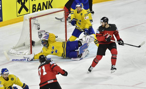 Sweden's Henrik Lundqvist makes a save in the overtime of the Ice Hockey World Championships final match between Canada and Sweden in the LANXESS arena in Cologne, Germany, Sunday, May 21, 2017. (AP Photo/Martin Meissner)