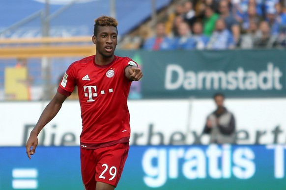 epa04938710 Munich's Kingsley Coman celebrates his goal during the German Bundesliga soccer match between SV Darmstadt 98 and FC Bayern Munich in Darmstadt, Germany, 19 September 2015.(EMBARGO CONDITIONS - ATTENTION: Due to the accreditation guidelines, the DFL only permits the publication and utilisation of up to 15 pictures per match on the internet and in online media during the match.)  EPA/FREDRIK VON ERICHSEN