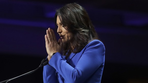 Democratic presidential candidate Rep. Tulsi Gabbard, D-Hawaii, gestures after speaking during the 2019 California Democratic Party State Organizing Convention in San Francisco, Saturday, June 1, 2019. (AP Photo/Jeff Chiu)