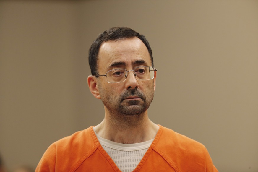 Dr. Larry Nassar, 54, appears in court for a plea hearing in Lansing, Mich., Wednesday, Nov. 22, 2017. Nasser, a sports doctor accused of molesting girls while working for USA Gymnastics and Michigan State University, pleaded guilty to multiple charges of sexual assault and will face at least 25 years in prison. (AP Photo/Paul Sancya)