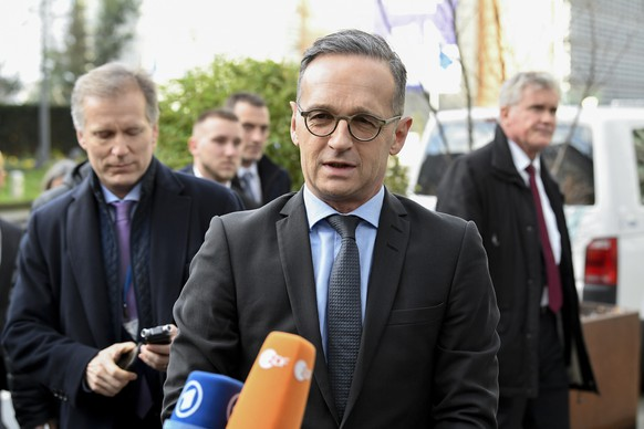 German Foreign Minister Heiko Maas, center, speaks with the media as he arrives to meet with Italian Foreign Minister Luigi Di Maio, French Foreign Minister Jean-Yves Le Drian, British Foreign Secretary Dominic Raab and European Union foreign policy chief Josep Borrell to discuss the situation in Libya at the EEAS building in Brussels, Tuesday, Jan. 7, 2020. The ministers will also hold talks later Tuesday which are expected to center on the situation in Iran and Iraq. (John Thys, Pool Photo via AP)