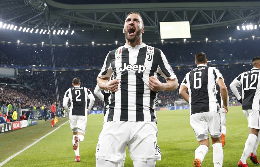 Juventus' Gonzalo Higuain celebrates after scoring his side's opening goal during the Champions League, round of 16, first-leg soccer match between Juventus and Tottenham Hotspurs, at the Allianz Stadium in Turin, Italy, Tuesday, Feb. 13, 2018. (AP Photo/Antonio Calanni)