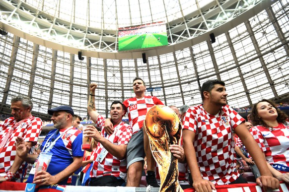 epa06890309 Supporters of Croatia prior the FIFA World Cup 2018 final between France and Croatia in Moscow, Russia, 15 July 2018.  (RESTRICTIONS APPLY: Editorial Use Only, not used in association with any commercial entity - Images must not be used in any form of alert service or push service of any kind including via mobile alert services, downloads to mobile devices or MMS messaging - Images must appear as still images and must not emulate match action video footage - No alteration is made to, and no text or image is superimposed over, any published image which: (a) intentionally obscures or removes a sponsor identification image; or (b) adds or overlays the commercial identification of any third party which is not officially associated with the FIFA World Cup)  EPA/FACUNDO ARRIZABALAGA   EDITORIAL USE ONLY