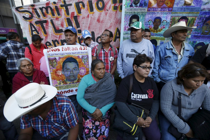 Relatives of the 43 students missing from Ayotzinapa College Raul Isidro Burgos take part in a news conference after a meeting with Mexico's Attorney General Arely Gomez at her office, in Mexico City, Mexico, January 14, 2016. The 43 students disappeared in the southwestern state of Guerrero in late 2014. REUTERS/Edgard Garrido