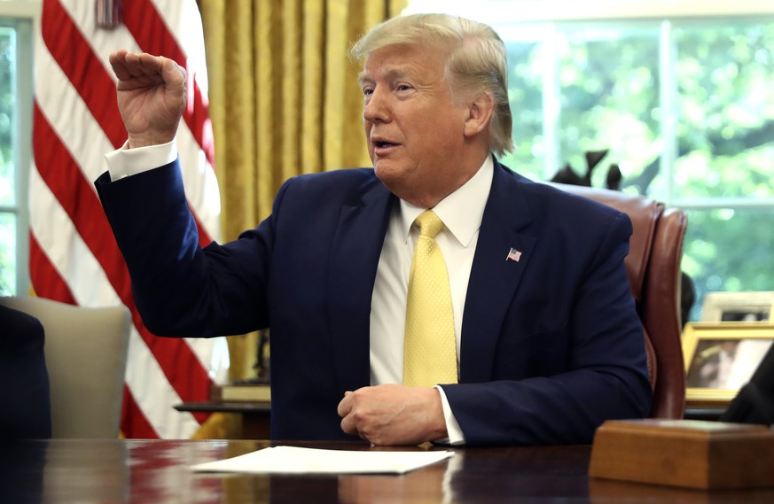 President Donald Trump speaks as he meets with Chinese Vice Premier Liu He in the Oval Office of the White House in Washington, Friday, Oct. 11, 2019. (AP Photo/Andrew Harnik) Donald Trump,Liu He