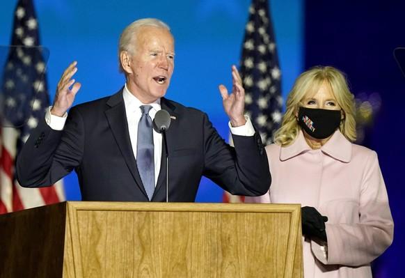Democratic presidential candidate former Vice President Joe Biden speaks to supporters Wednesday, Nov. 4, 2020, in Wilmington, Del., as he stands next to his wife Jill Biden. (AP Photo/Andrew Harnik) Joe Biden