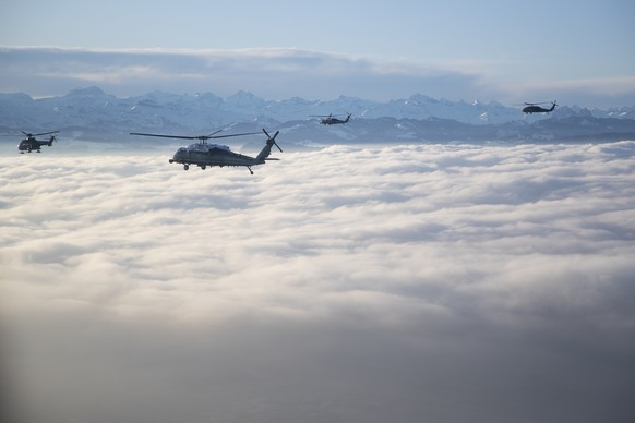Marine One carrying US President Donald Trump travels to the Davos landing zone in Switzerland, Tuesday, Jan. 21, 2020. President Trump arrived in Switzerland on Tuesday to start a two-day visit to the World Economic Forum. (AP Photo/Evan Vucci) Donald Trump