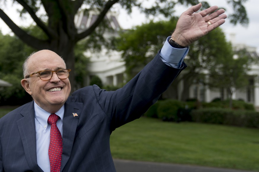 FILE - In this Tuesday, May 29, 2018 file photo, Rudy Giuliani, an attorney for President Donald Trump, waves to people during White House Sports and Fitness Day on the South Lawn of the White House, in Washington. Speaking to the Globes capital market conference in Tel Aviv, Israel, Giuliani said Wednesday, June 6, 2018, that special counsel Robert Mueller's team is trying to frame Trump. Giuliani said that Mueller's team includes