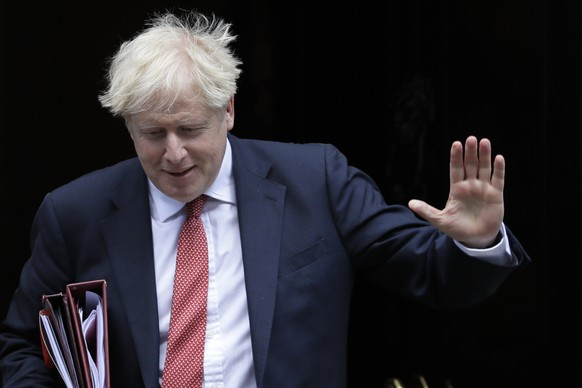 Britain's Prime Minister Boris Johnson leaves Downing Street in London, Wednesday, Sept. 2, 2020. The Prime Minister will attend the first session of Prime Ministers Questions since parliament returned Tuesday after the summer break. (AP Photo/Kirsty Wigglesworth)