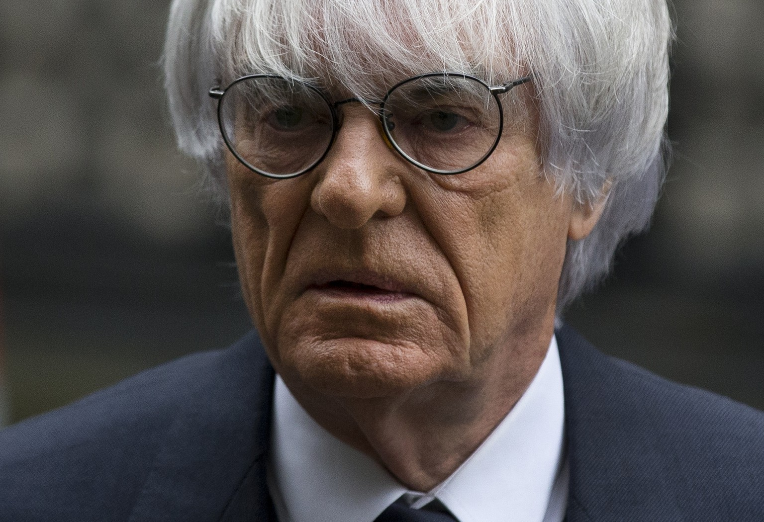FILE - In this Nov. 11, 2013 file picture President and CEO of Formula One Management Bernie Ecclestone arrives for his case at the High Court in London. Ecclestone goes on trial in Munich on Thursday, April 24, 2014, on bribery charges that could put him in prison for up to 10 years if convicted. The trial could spell the end of the 83-year-old Ecclestone's career in the racing series that has become a lucrative business under his guidance. (AP Photo/Matt Dunham, File)