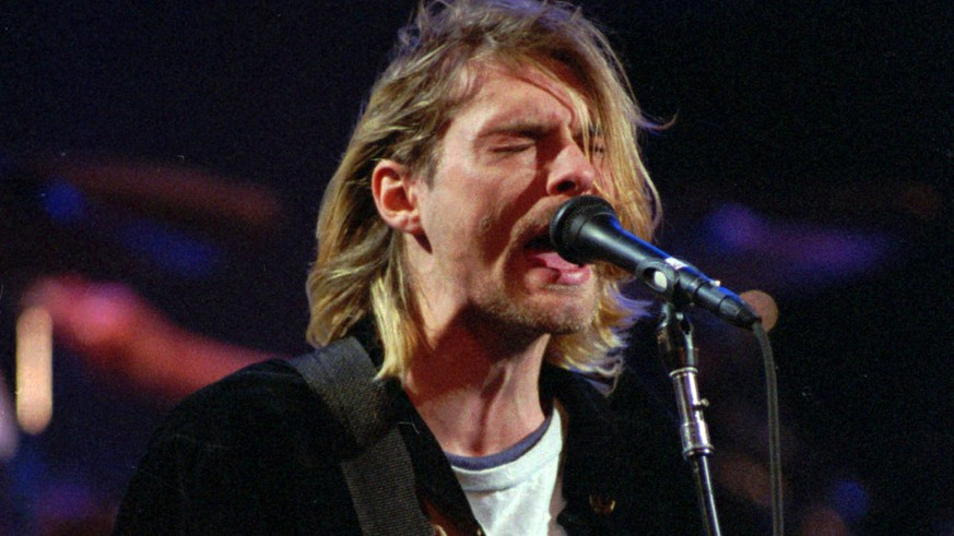 FILE - This Dec. 13, 1993 file photo shows Kurt Cobain of the Seattle band Nirvana performing in Seattle, Wash. Nirvana, which changed music and fashion in the 1990s with the punk rock-inspired grunge sound, is joining the Rock and Roll Hall of Fame in a class with Kiss, Peter Gabriel and Hall & Oates. Nirvana is being inducted in its first year of eligibility. The trio's