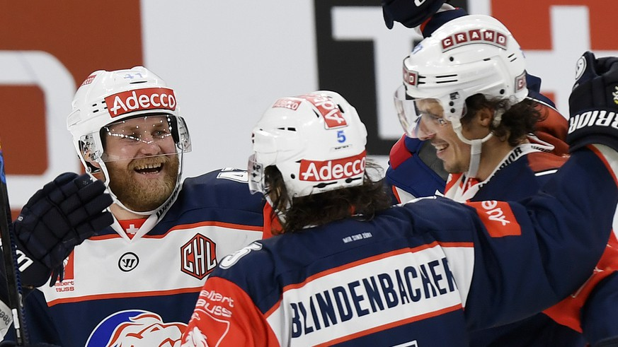 Zurich's scorer Roman Wick, right, Severin Blindenbacher, center, and Patrick Thoresen, left, celebrate their victory in the ice hockey Champions League match 1/8 Final between ZSC Lions and HC Lugano in Zurich, Switzerland, Wednesday, November 09, 2016. (KEYSTONE/Walter Bieri)