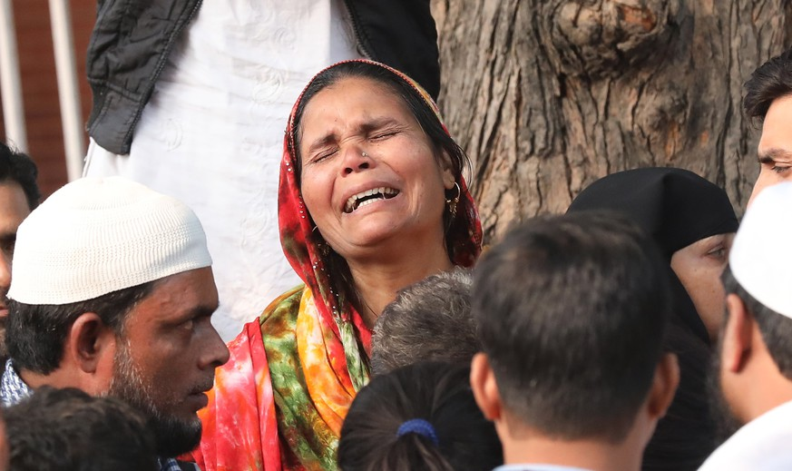 epa08054362 The relative of a victim of the New Delhi building fire reacts outside the emergency ward of Lok Nayak Hospital, in New Delhi, India, 08 December 2019. According to news reports, at least 43 people were killed after a fire broke out at a building in New Delhi's Anaj Mandi area on the morning of 08 December.  EPA/HARISH TYAGI