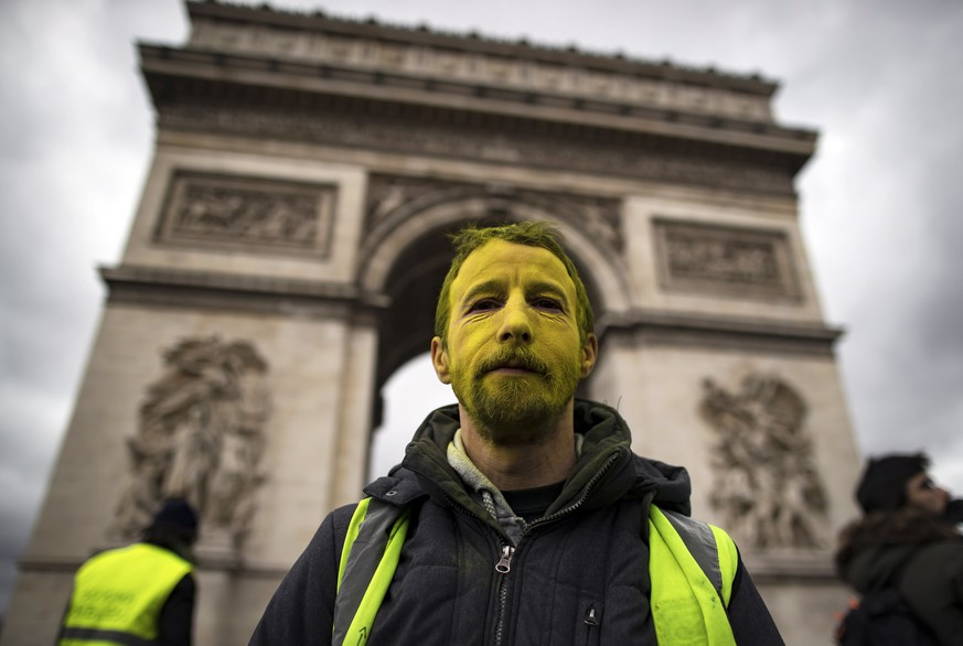 epa07424971 A protester from the 'Gilets Jaunes' (Yellow Vests) movement walks down the Champs Elysees avenue near the Arc de Tiomphe during the 'Act XVII' demonstration (the 17th consecutive national protest on a Saturday) in Paris, France, 09 March 2019. The so-called 'Gilets Jaunes' is a grassroots protest movement with supporters from a wide span of the political spectrum, that originally started with protest across the nation in late 2018 against high fuel prices.  EPA/IAN LANGSDON
