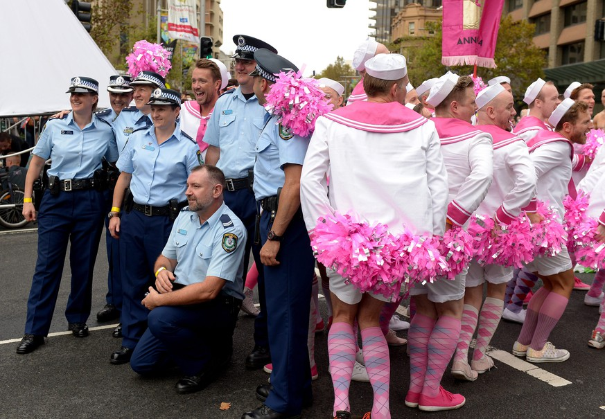 epa04104506 NSW Police pose for photographs with parade goers ahead of the start of the Gay and Lesbian Mardi Gras parade in Sydney, Australia, 01 March 2014. Sydney's gay and lesbian parade reprised its past as a protest march Saturday with several of the 144 floats making fun of Russian leader Vladimir Putin's conservative views on sexuality. More than 10,000 marchers closed the month-long Mardi Gras festival. Hundreds of thousands were there to watch - despite days of rain driving down temperatures for the end-of-summer shindig.  EPA/DAN HIMBRECHTS AUSTRALIA AND NEW ZEALAND OUT