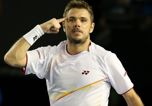 epa04038012 Stanislas Wawrinka of Switzerland celebrates after winning his match against Tomas Berdych of the Czech Republic during his match against in the semifinals of the Australian Open tennis tournament in Melbourne, Australia, 23 January 2014.  EPA/MARK DADSWELL