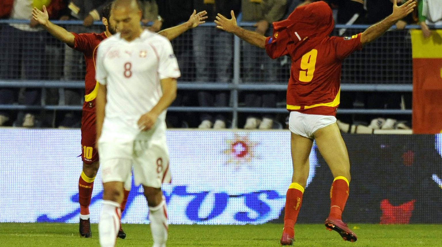 Montenegro forward Mirko Vucinic, right, celebrates the first goal in front of Swiss midfielder Goekhan Inler, left, during the Euro 2012 group G qualification soccer match between Switzerland and Montenegro at the City Stadium, in Podgorica, Montenegro, Friday, October 8, 2010. (KEYSTONE/Laurent Gillieron)