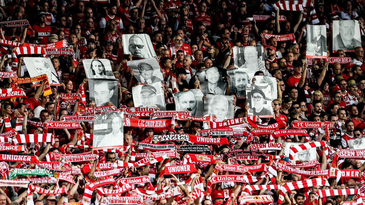 epa07779535 Union's fans players cheer prior the German Bundesliga soccer match between FC Union Berlin and RB Leipzig  in Berlin, Germany, 18 August 2019.  EPA/HAYOUNG JEON CONDITIONS - ATTENTION: DFL regulations prohibit any use of photographs as image sequences and/or quasi-video.