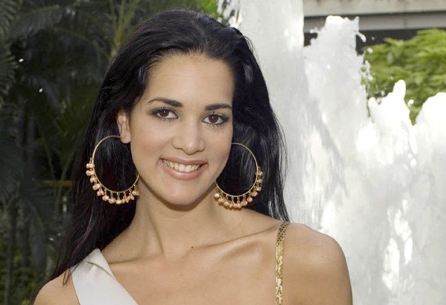 FILE - This May 23, 2005 file photo, released by Miss Universe shows Monica Spear, Miss Venezuela 2005, posing for a portrait ahead of the Miss Universe competition in Bangkok, Thailand. Three men who confessed to murdering the former Miss Venezuela and her husband in a crime that shocked a nation increasingly accustomed to violence have each been sentenced this Tuesday Sept. 23 2014, to more than 20 years in jail. (AP Photo/Miss Universe Darren Decker, File)