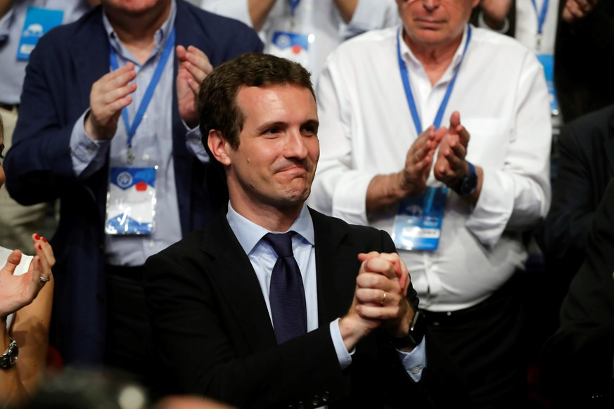 epa06902317 The newly-elected President of the Spanish conservative People's Party (PP), Pablo Casado (L), reacts during the People's Party (PP) national congress in Madrid, Spain, 21 July 2018. Casado and Saenz de Santamaria were both running to take over the party's chair from former Prime Minister and outgoing party leader Mariano Rajoy.  EPA/JUAN CARLOS HIDALGO