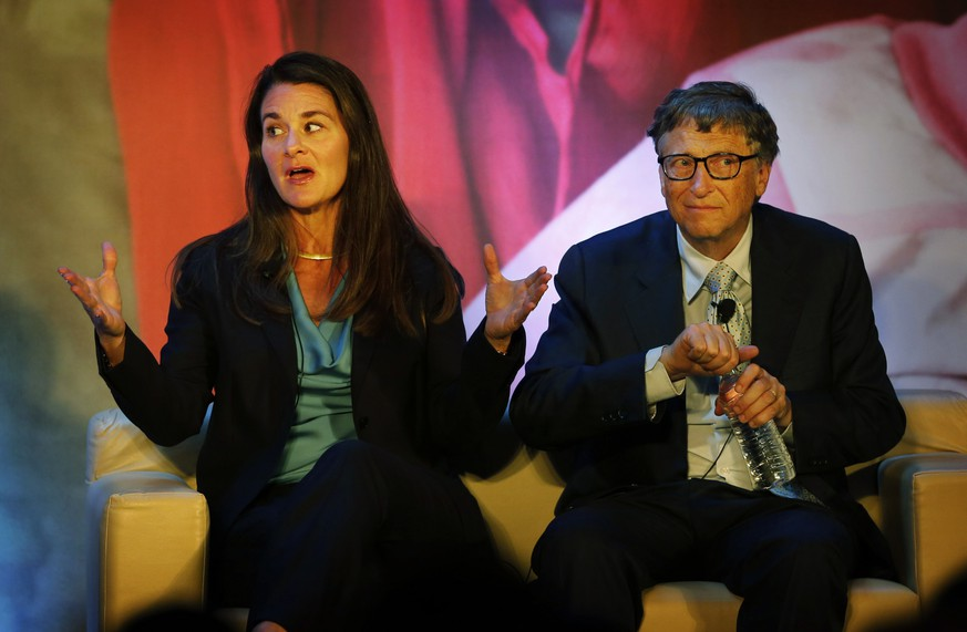 FILE - In this Sep. 16, 2019 file photo, Melinda Gates, left, talks to Indian author Chetan Bhagat, unseen, as Bill Gates looks at the audience during an interaction organized by the Bill and Melinda Gates foundation in New Delhi, India. Bill and Melinda Gates aren't backing down from honoring India Prime Minister Narendra Modi despite concerns about human rights abuses in the disputed Kashmir region. A group delivered 100,000 petition signatures to the Gates Foundation's Seattle headquarters Monday, Sept. 16, 2019, asking the world's largest private nonprofit not to honor Modi's sanitation initiative that improved access to toilets. The Foundation says it respects the petitioners but that Modi will receive its Goalkeepers Global Goals Award. (AP Photo/Manish Swarup, File) Melinda Gates,Bill Gates
