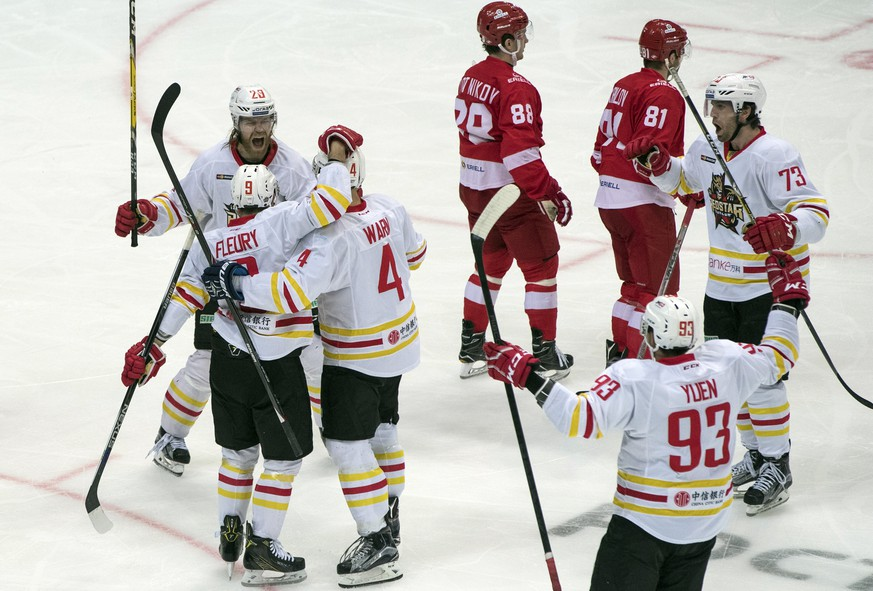 Kunlun Red Star's team players celebrate after scoring a goal during the Kontinental Hockey League match between Spartak Moscow and Kunlun Red Star in Moscow, Russia, Saturday, Oct. 1, 2016. (AP Photo/Pavel Golovkin)