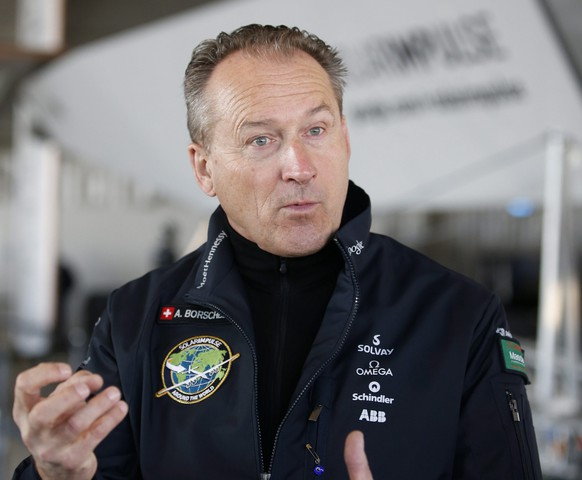 epa04644049 One of the pilots of Solar Impulse 2 Andre Borschberg talks to media after doing the third test flight in Abu Dhabi, UAE, 02 March 2015. After Solar Impulse 2 successfully accomplished the first test flight since the reassembly with the test pilot Markus Scherdel at the controls, the Solar Impulse 2 made the third test on 02 March 2015 with pilot Bertrand Piccard,. Solar Impulse 2, the only solar single-seater airplane able to fly day and night without a drop of fuel, will attempt the First Round-The-World Solar Flight in 07 March 2015. The aircraft departing from Abu Dhabi. Swiss founders and pilots, Bertrand Piccard and Andre Borschberg, will take turns flying Solar Impulse 2 over the Arabian Sea, to India, Myanmar, China, then across the Pacific Ocean, to the United States, and over the Atlantic Ocean to Southern Europe or Northern Africa before finishing the journey by returning to the initial departure point.  EPA/ALI HAIDER