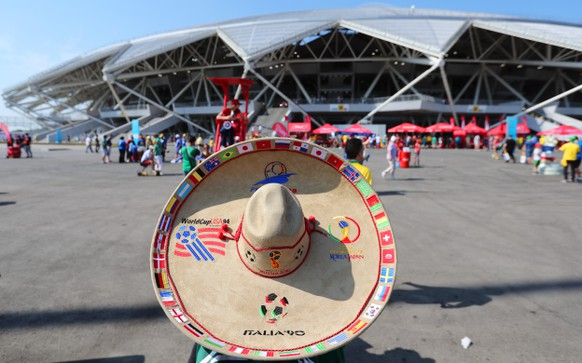 epa06857701 A supporter of Mexico arrives at the Cosmos Arena for the FIFA World Cup 2018 round of 16 soccer match between Brazil and Mexico in Samara, Russia, 02 July 2018.  EPA/TATYANA ZENKOVICH