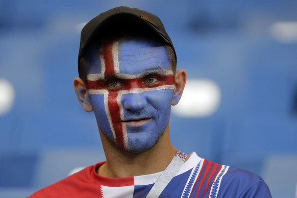 An Iceland fan sits on the stands prior to the start of the group D match between Iceland and Croatia, at the 2018 soccer World Cup in the Rostov Arena in Rostov-on-Don, Russia, Tuesday, June 26, 2018. (AP Photo/Natacha Pisarenko)