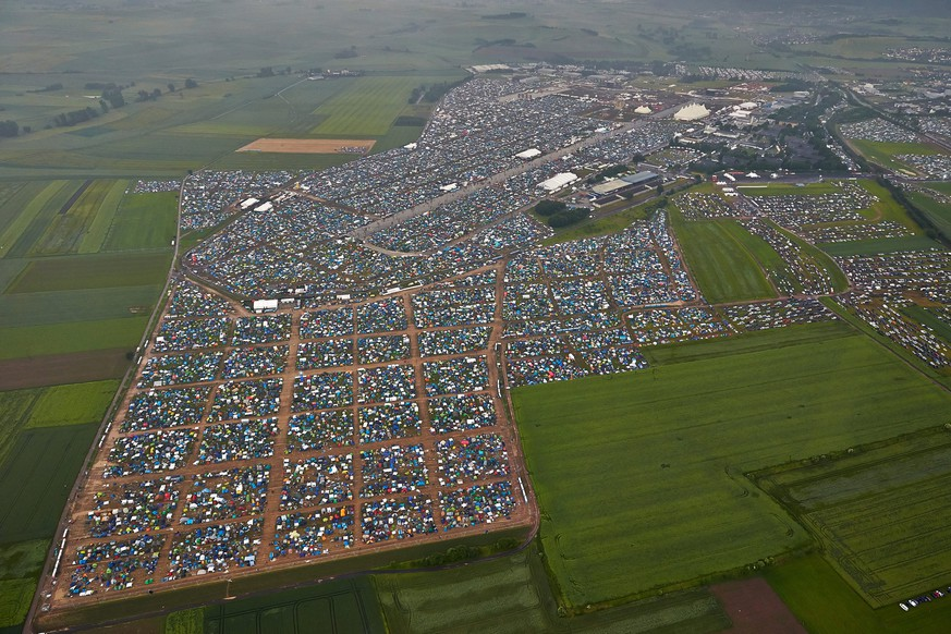 epa05346124 An aerial view from the the grounds of the festival 'Rock am Ring' in Mendig, Germany, 04 June 2016. The event originally took place at the Nuerburgring circuit before it closed its doors in 2014. The 31th edition of the festival takes place on a former military airfield in Mendig from 03 to 05 June.  EPA/THOMAS FREY