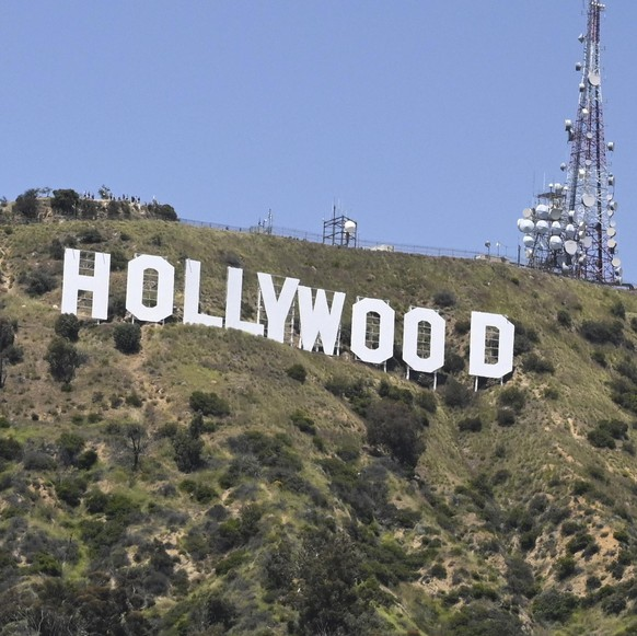 People wait for the Thunderbirds flyover the famed Hollywood sign but were disappointed when they flew several miles south of the sign during the coronavirus outbreak, Friday, May 15, 2020, in Los Angeles. (AP Photo/Mark J. Terrill)