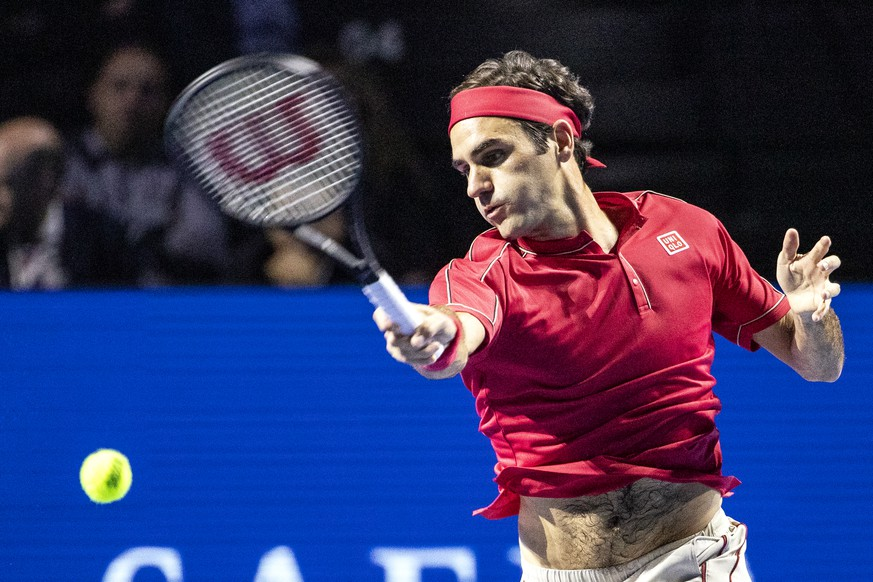 Roger Federer of Switzerland returns a ball to Alex De Minaur of Australia during their final match at the Swiss Indoors tennis tournament at the St. Jakobshalle in Basel, Switzerland, on Sunday, October 27, 2019. (KEYSTONE/Alexandra Wey)