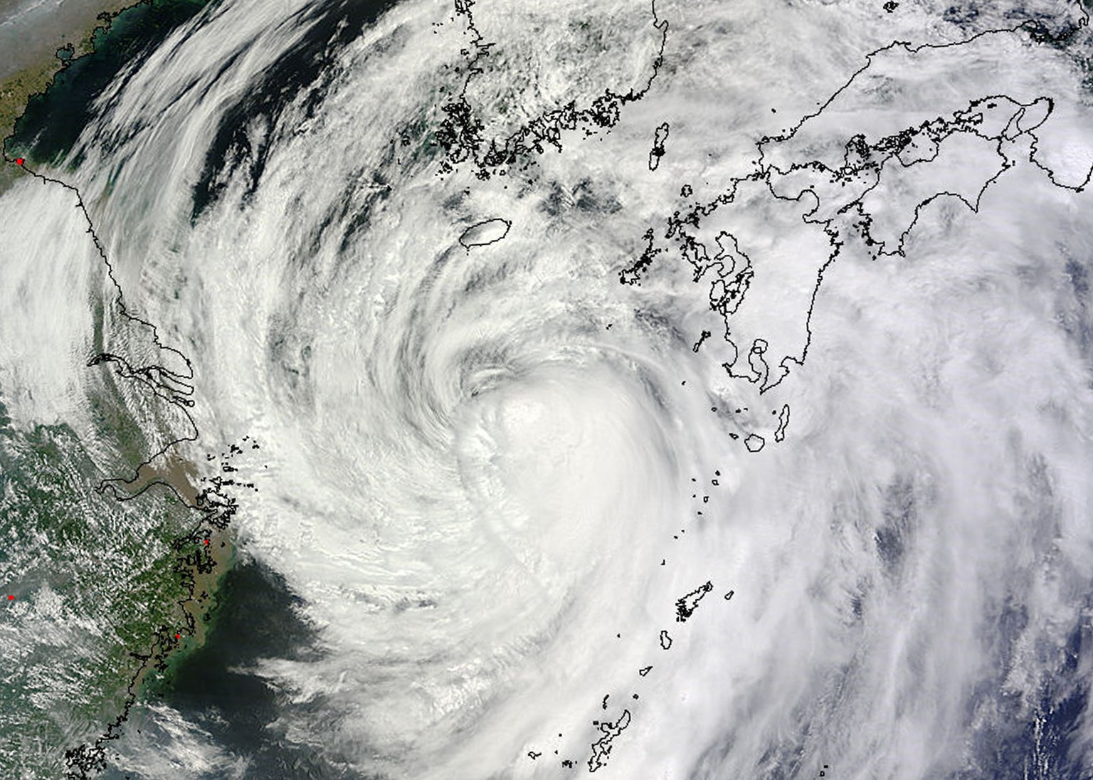 A Moderate Resolution Imaging Spectroradiometer (MODIS) image from  NASA's Terra satellite shows Typhoon Neoguri in the Pacific Ocean approaching Japan's main islands on its northward journey July 9, 2014. Torrential rains from a weakened but still dangerous typhoon battered Japan's Okinawa islands on Wednesday, leaving two dead and threatening widespread flooding as the storm headed for the nation's main islands. Picture taken July 9, 2014. REUTERS/NOAA/Handout via Reuters (DISASTER ENVIRONMENT)  ATTENTION EDITORS - THIS PICTURE WAS PROVIDED BY A THIRD PARTY. REUTERS IS UNABLE TO INDEPENDENTLY VERIFY THE AUTHENTICITY, CONTENT, LOCATION OR DATE OF THIS IMAGE. FOR EDITORIAL USE ONLY. NOT FOR SALE FOR MARKETING OR ADVERTISING CAMPAIGNS. THIS PICTURE WAS PROCESSED BY REUTERS TO ENHANCE QUALITY. AN UNPROCESSED VERSION WILL BE PROVIDED SEPARATELY